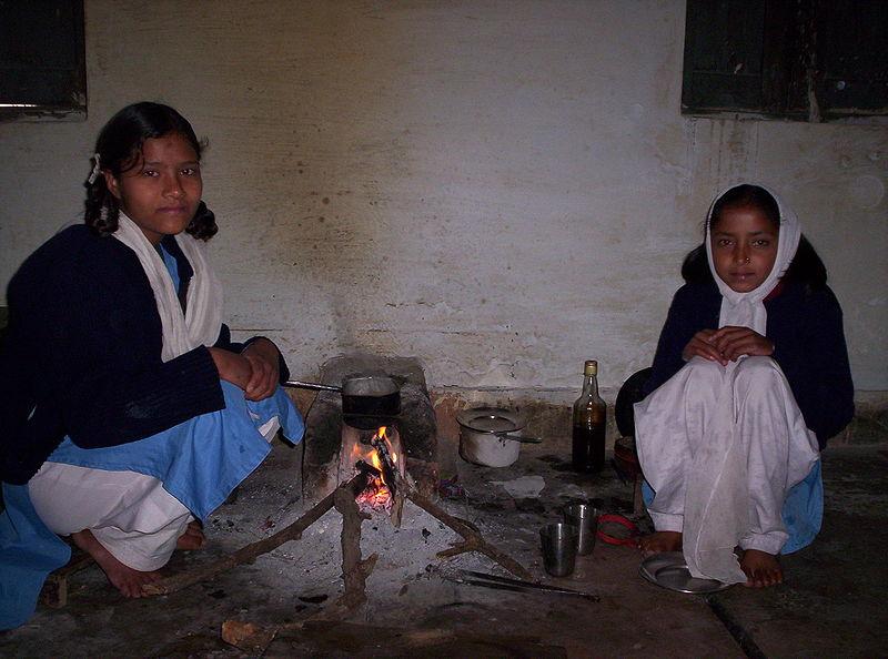 Indian Girls Making Tea Over an Open Fire