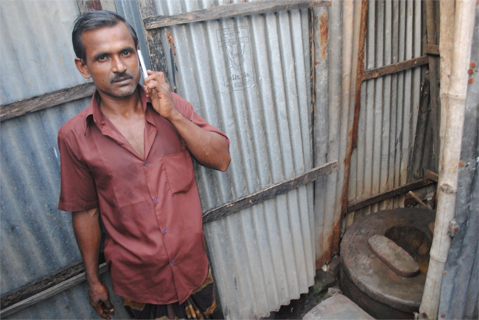 Abdul Malik, a 35-year-old rickshaw puller from Dhaka, shares a communal toilet
