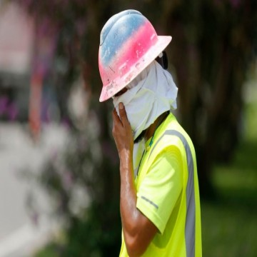 Construction Worker Wipes his Sweat
